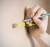 Measuring with tape measure Royalty Free Stock Photos