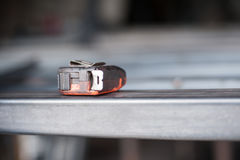 Measuring tape on metal table in the workshop. Close up Stock Photo