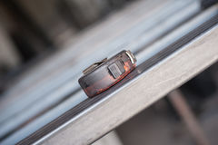 Measuring tape on metal table in the workshop. Close up Royalty Free Stock Photo
