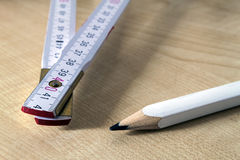 Measuring tape meter and pensil. Construction tools. Stock Photography