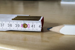 Measuring tape meter and pensil. Construction tools. Royalty Free Stock Photography
