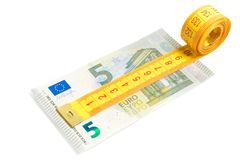 Measuring tape on new five euro banknote Royalty Free Stock Images