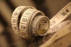 Measuring tape numbers strip brown white background roll Royalty Free Stock Photography