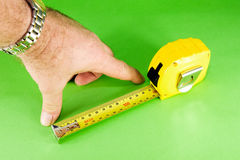 Measuring Tape On Green Background Stock Photos