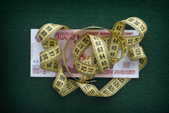 Measuring tape over five thousand rubles banknote Stock Photos