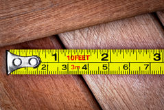 Measuring tape over wooden boards Stock Photography