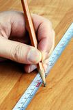 Measuring tape and pencil Royalty Free Stock Photo