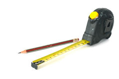 Measuring tape and pencil Royalty Free Stock Images