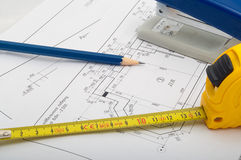 Measuring tape and pencil drawings. On premises royalty free stock photos