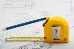 Measuring tape and pencil drawings. On premises stock images