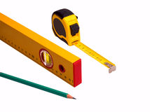 Measuring tape, pencil and level Royalty Free Stock Photography
