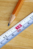 Measuring tape and pencil are tools for carpenters. Measuring tape and pencil are the tools for carpenters Royalty Free Stock Photography