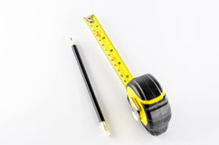 Measuring tape with pencil Royalty Free Stock Images