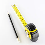 Measuring tape with pencil Stock Image