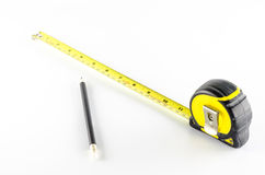 Measuring tape with pencil Stock Photo