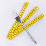 Measuring tape on plate Stock Photography