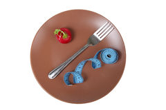 Measuring tape,radishes and fork on a plate Royalty Free Stock Photo
