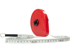 Measuring tape. Red measuring tape isolated on white background Stock Images