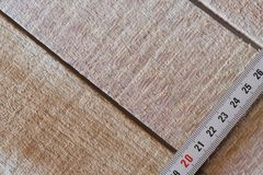 Measuring tape of roulette on wooden boards. Close-up Stock Images