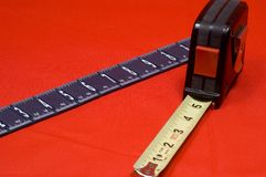 Measuring Tape and Ruler. On red background royalty free stock photography