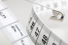 Measuring Tape and Safety Pin Stock Photos