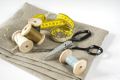 Measuring tape and scissors Stock Images