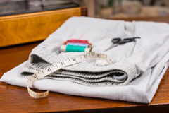 Measuring Tape, Scissors and Thread on a Trousers Royalty Free Stock Photos