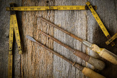 Measuring Tape and Screwdriver on Rustic Old Wood Stock Photography