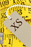 Measuring tape with size tag Royalty Free Stock Photography