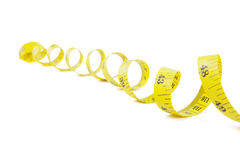 Measuring tape spiral on studio Stock Images