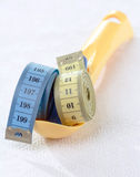 Measuring tape and spoon Royalty Free Stock Image