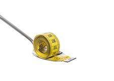 Measuring tape on spoon, concept of nutrition and diet Royalty Free Stock Images