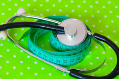 Measuring tape and stethoscope Stock Image