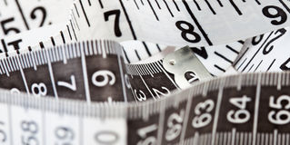 Measuring tape, symbol of tailoring and diets Stock Images