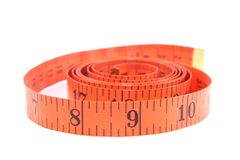 Measuring tape of the tailor. On the white background Royalty Free Stock Photography