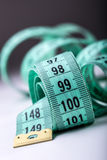 Measuring tape of the tailor. Closeup view of white measuring tape Royalty Free Stock Images