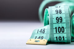 Measuring tape of the tailor. Closeup view of white measuring tape Royalty Free Stock Photos