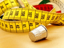 Measuring tape and thimble Stock Photos