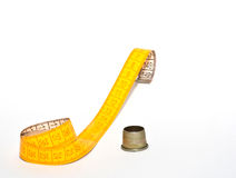measuring tape and thimble Stock Photography