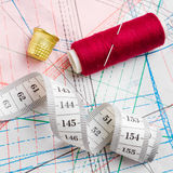 Measuring tape, thimble and bobbin of thread Stock Photography