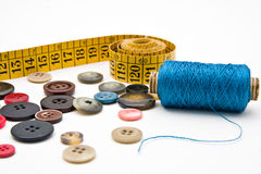 Measuring tape, thread bobbin and buttons. Measuring tape, thread bobbin and assorted buttons Royalty Free Stock Photo