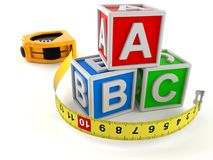 Measuring tape with toy blocks. Isolated on white background Stock Image
