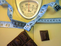 Measuring tape on weight scale Royalty Free Stock Photography