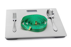 Measuring tape and weight scale Stock Images