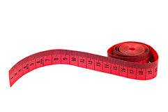 Measuring tape on white background red colour. Spiral and curved position showing centimetres Royalty Free Stock Image