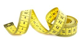 Yellow measuring tape spiral. Measuring tape  on white background Stock Photo