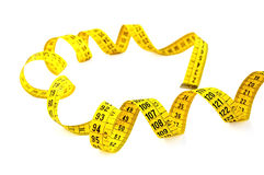 Measuring tape on white with clipping path. Royalty Free Stock Photo