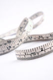 Measuring Tape. White measuring tape isolated on white background. Photographed in photographic tent Stock Photos