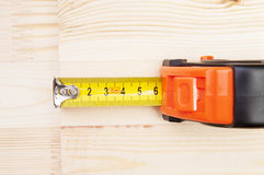 Measuring tape. On a wood plank royalty free stock photos