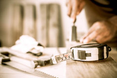 Measuring tape on a wood plank. Build concept Royalty Free Stock Photos